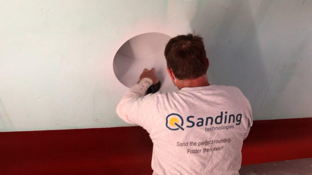 Sanding porthole with Q-Sander